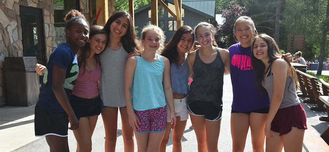 group of girls smiling at summer camp