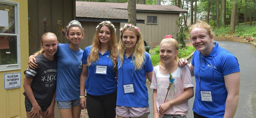 girls at summer camp similing