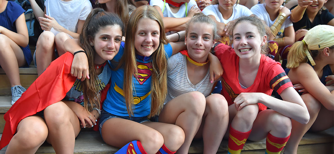 four girls dressed as super heroes