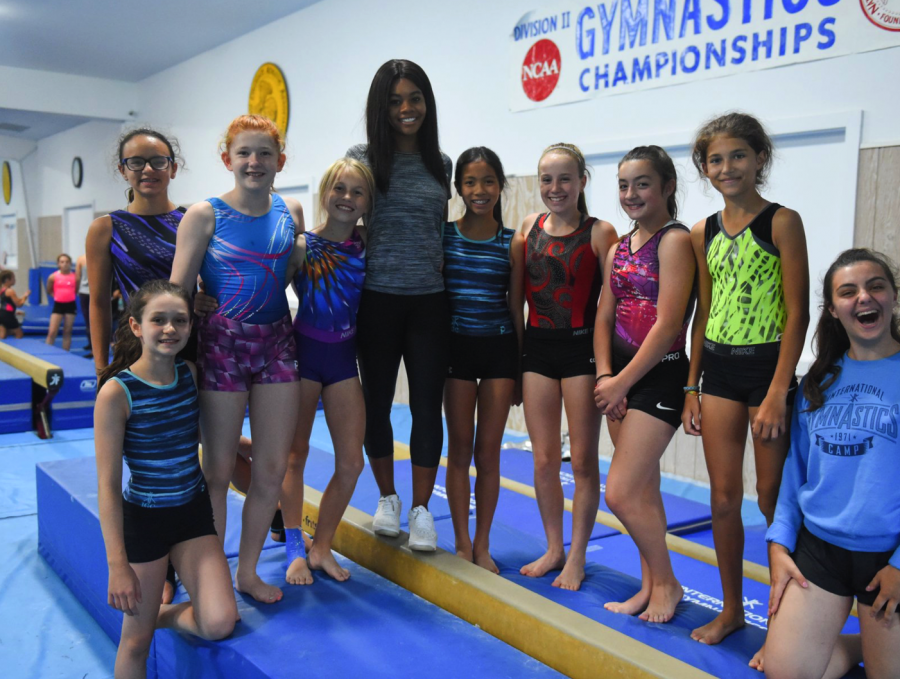 Gymnast Gabi with group of gymnast girls