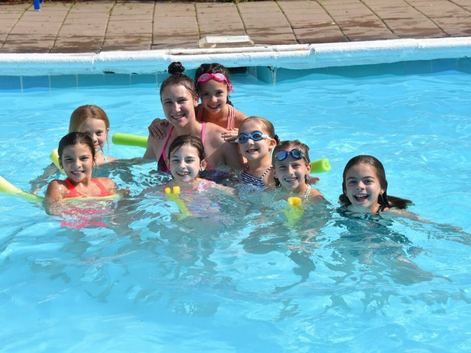 girls in the pool with one of their instructors