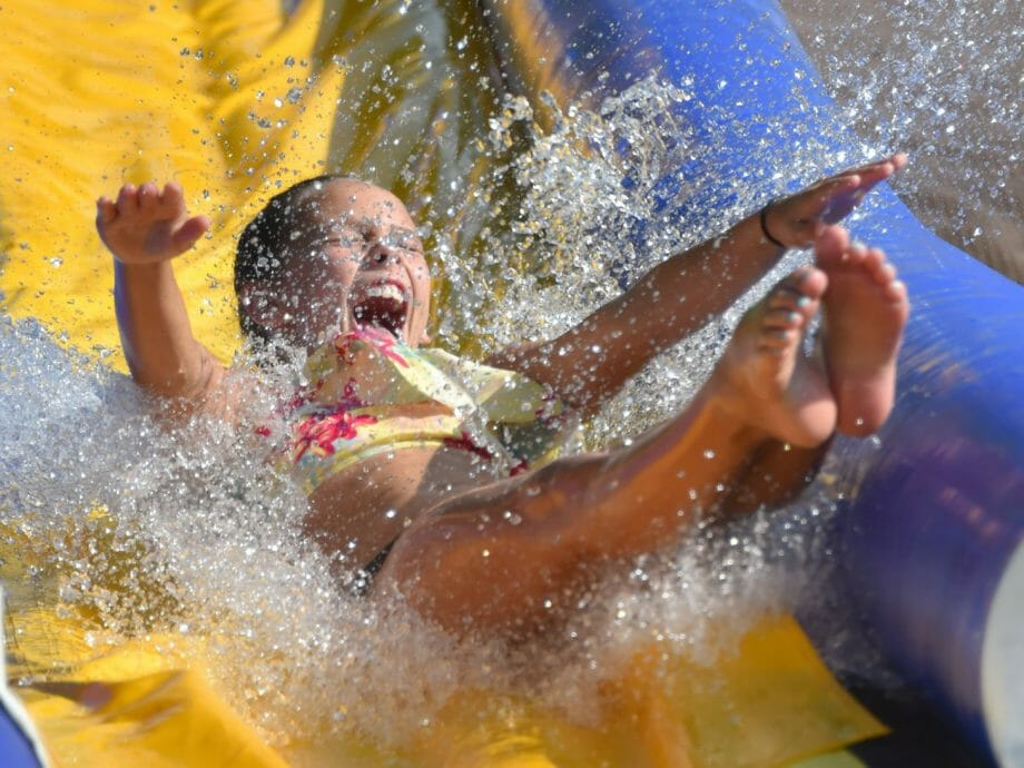 younger girl sliding down the waterslide