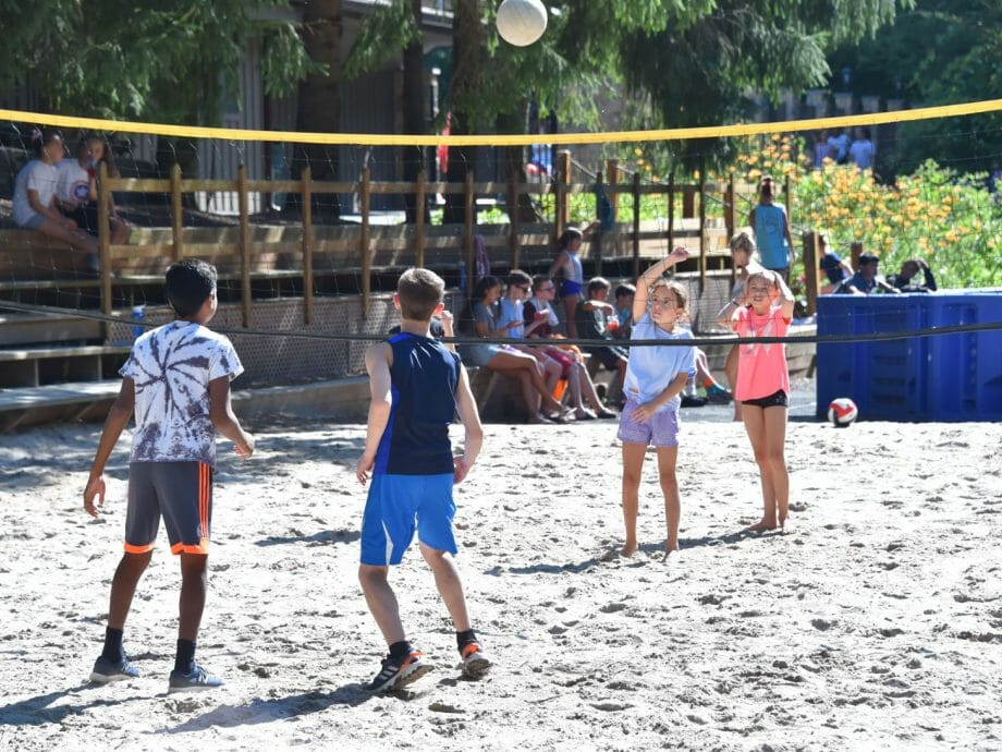 kids playing volleyball at camp