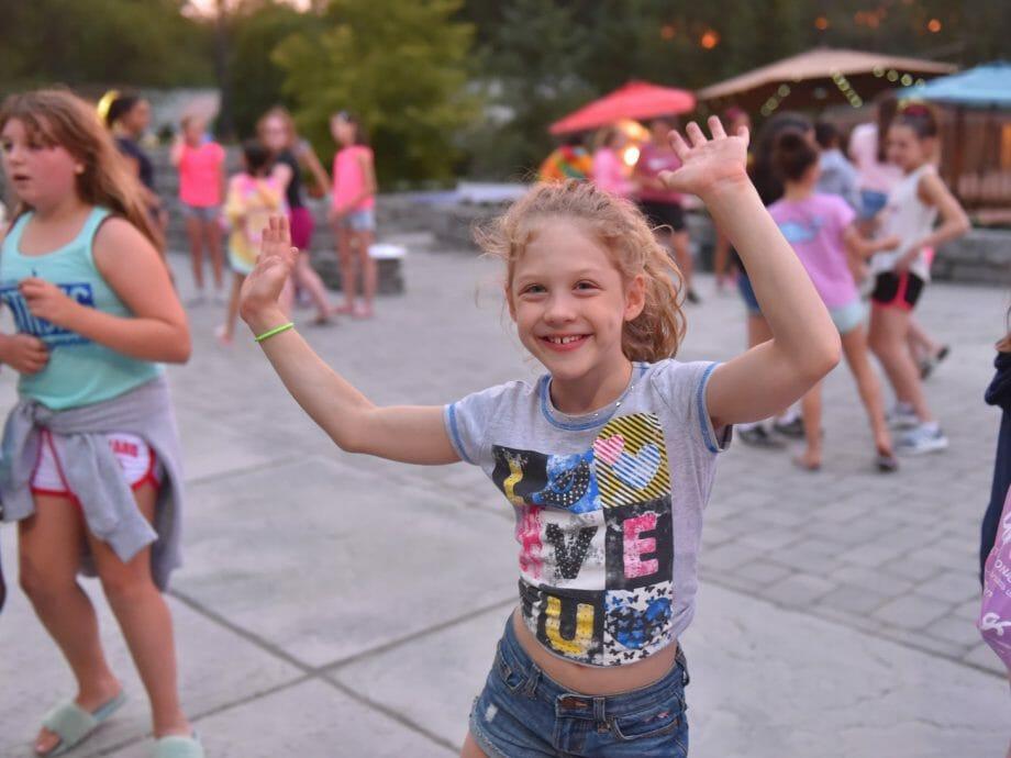 girl dancing during evening activities