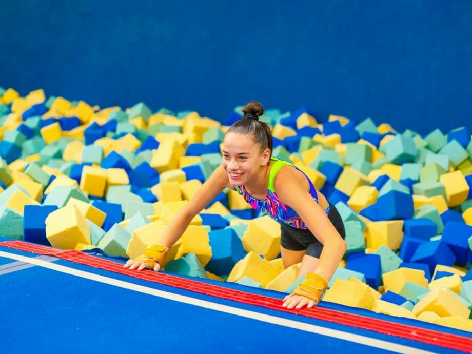 girl getting out of one of the foam pits
