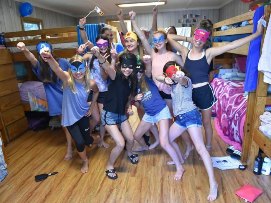 girls in their cabin dressed as superheroes