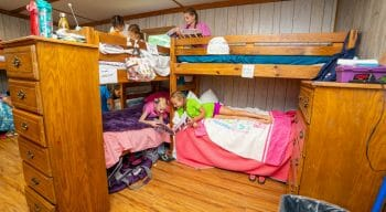 interior of one of the cabins with campers in their bunk beds