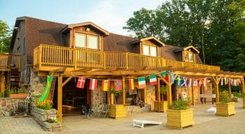 large cabin with balcony and string of flags hanging outside