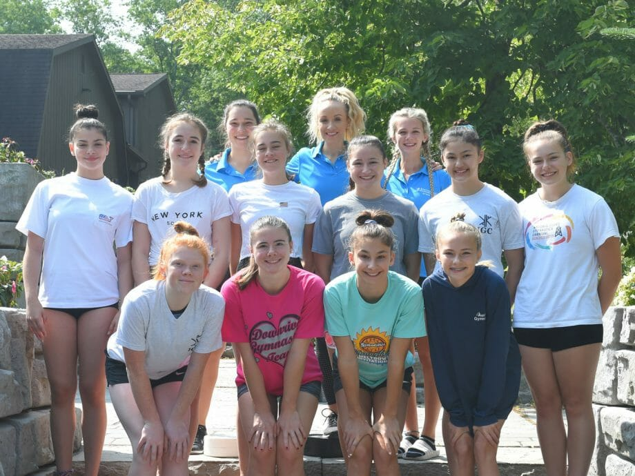 Nastia Liukin posing for a photo with campers