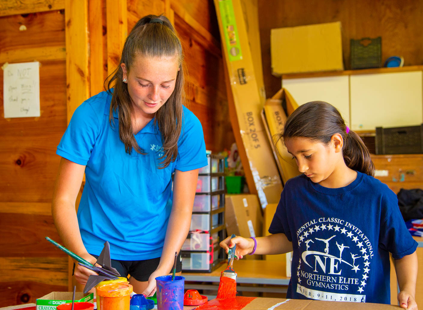 camper and counselor painting
