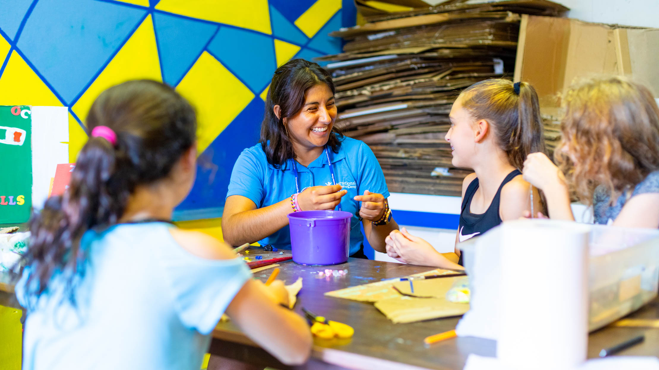 recreation leader crafting with campers