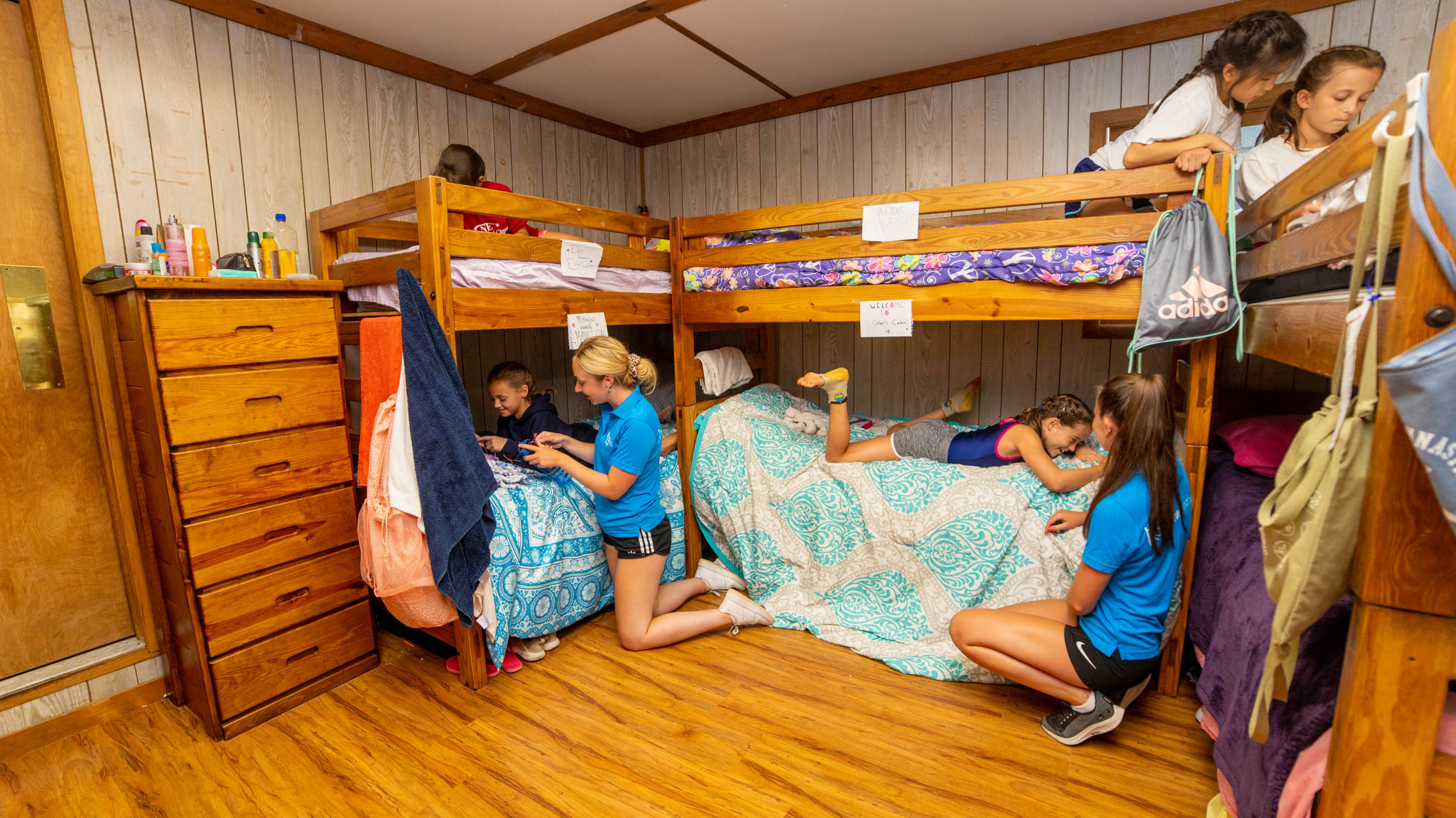 counselors in a cabin with campers