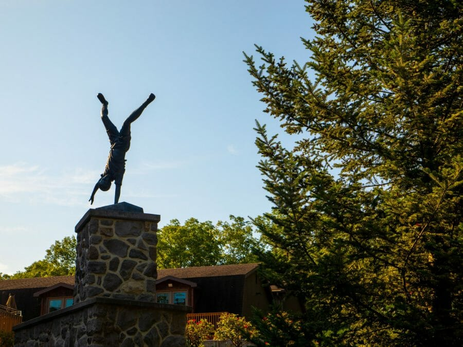 statue of a younger gymnast doing a one-handed handstand