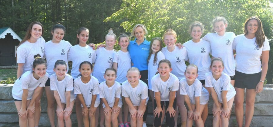 Celebrity guest Nastia Liukin posing with campers