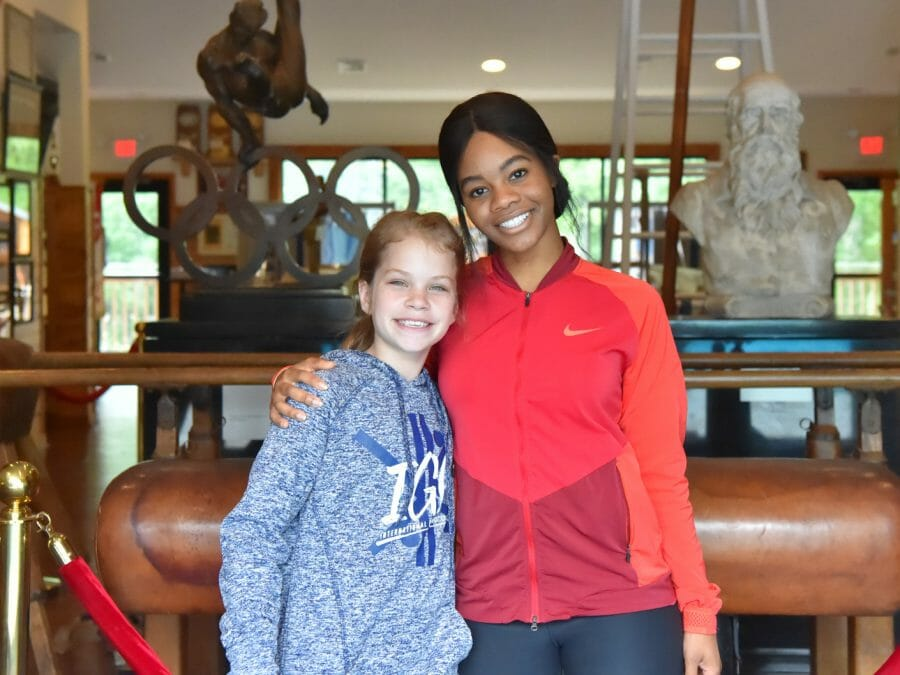 Celebrity guest Gabby Douglas with a camper
