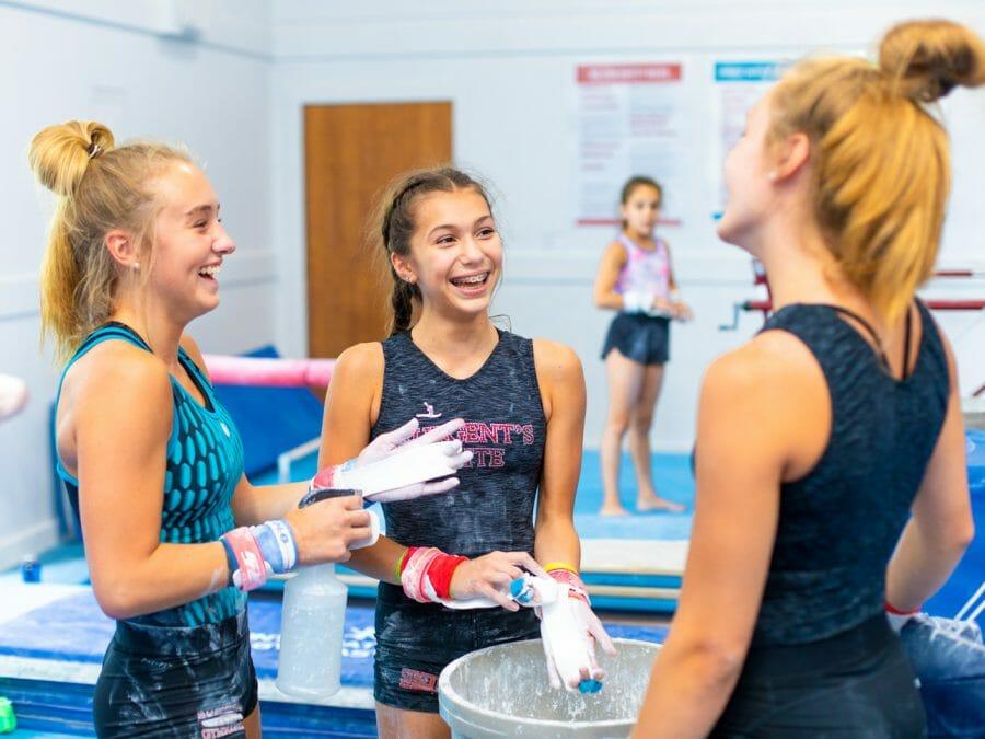 three girls chatting before their next routine