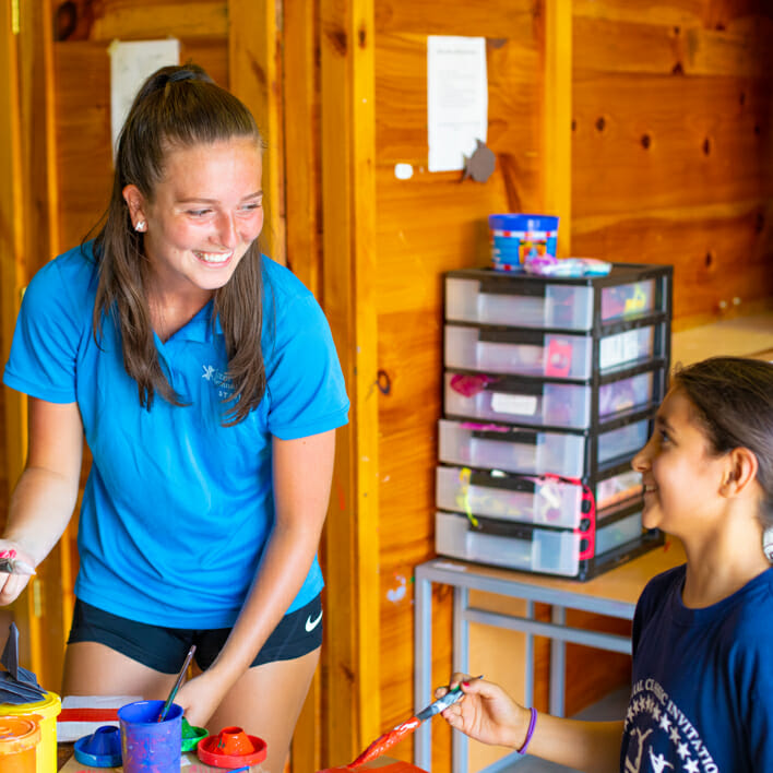 counselor and camper during arts and crafts times