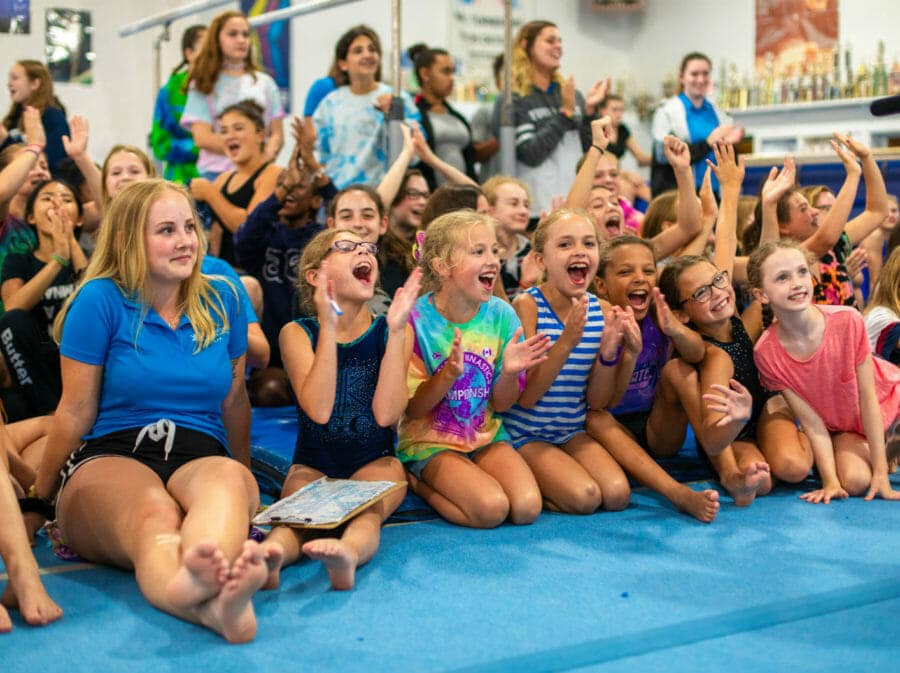 kids on a mat cheering