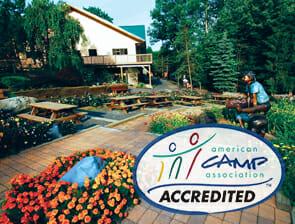 American Camp Association Logo on image of camp