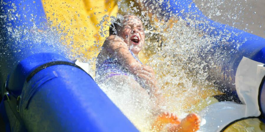 a girl going down a water slide