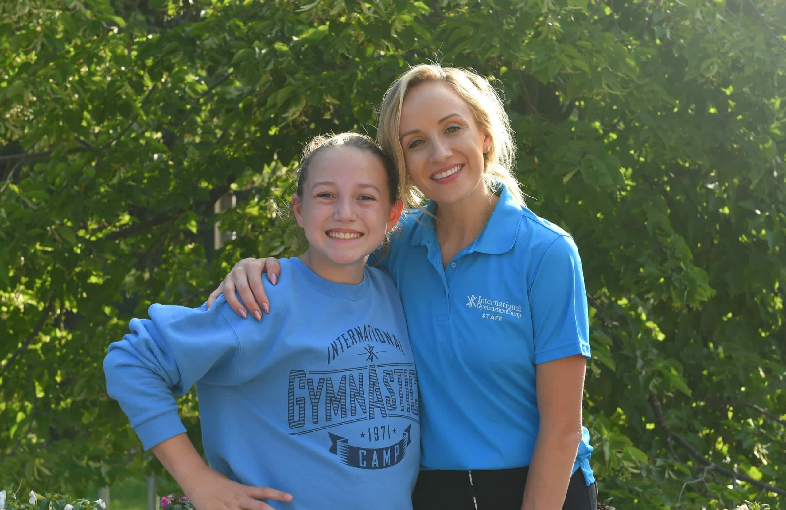 Nastia Liukin and young female gymnast