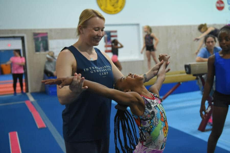 young girl learning gymnastics with Svetlana Boguinskaia