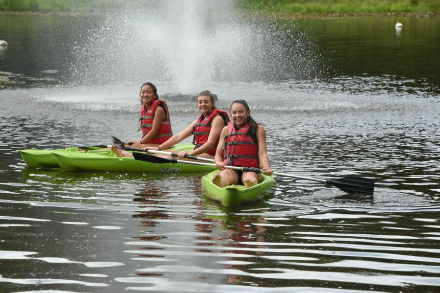 young girls kayaking