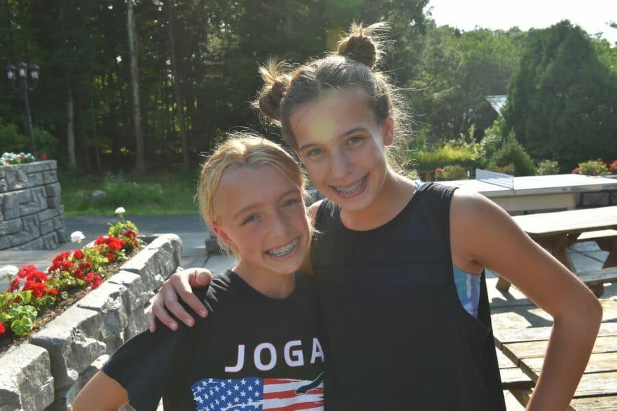 girls smiling at international gymnastics camp