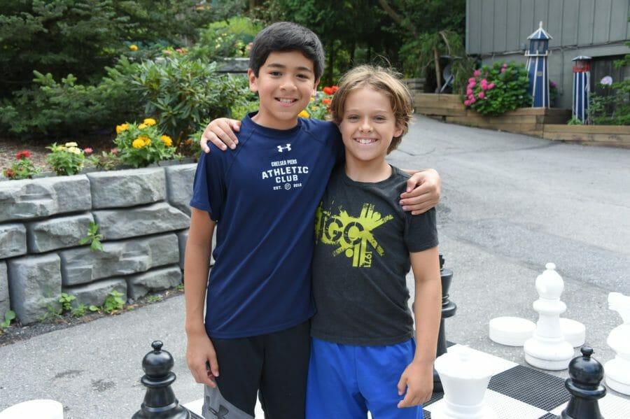 two boys hugging at international gymnastics camp