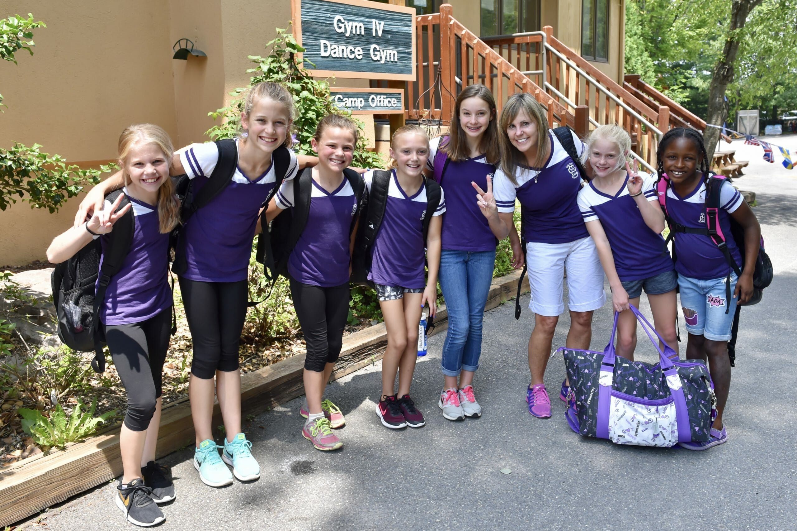 summer campers smiling in front of dance gym at IGC