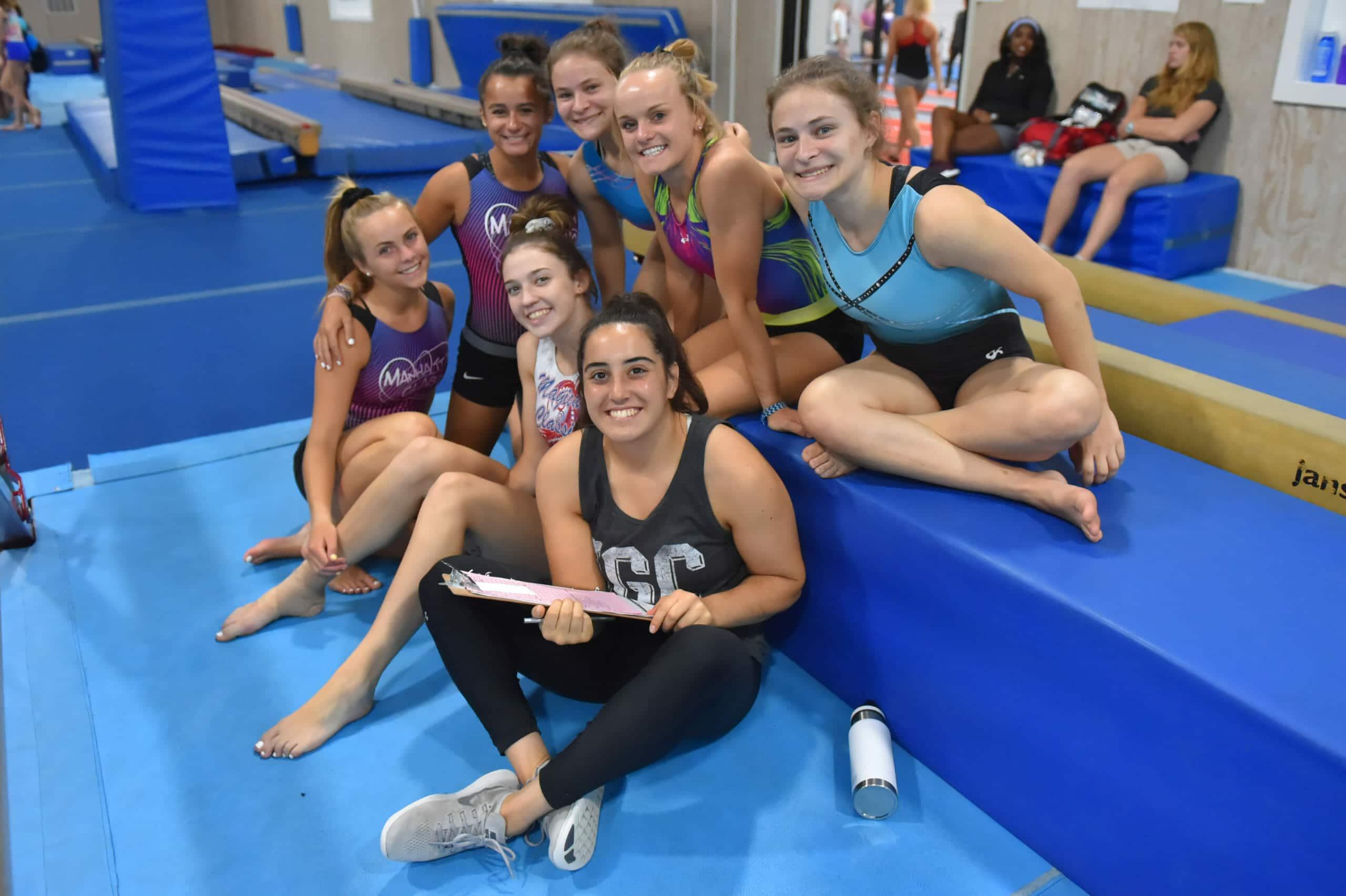 gymnastics coach and girls at IGC
