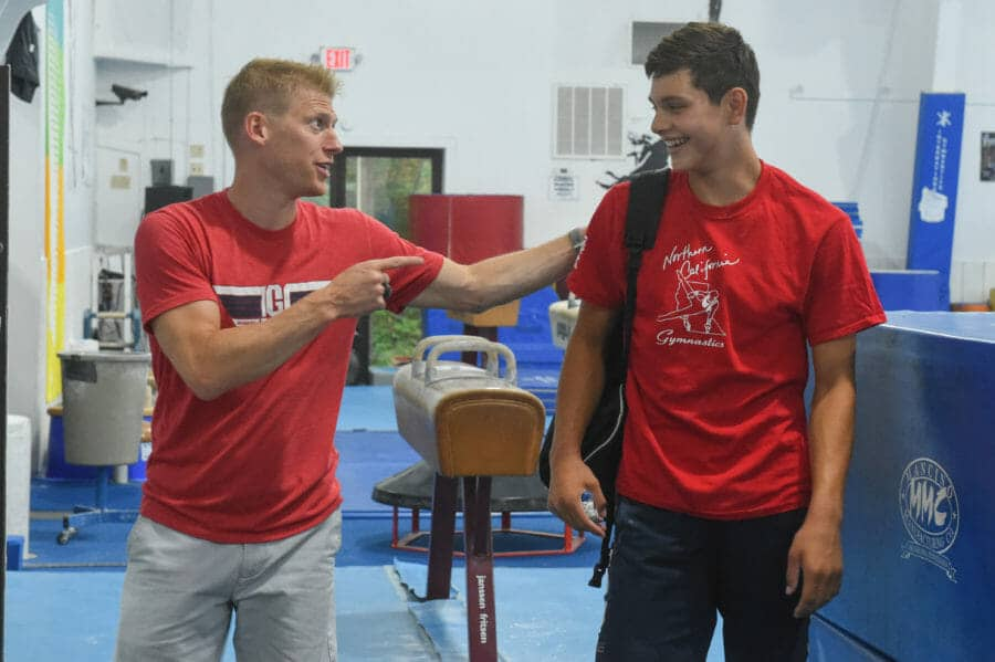 coach laughing with camper