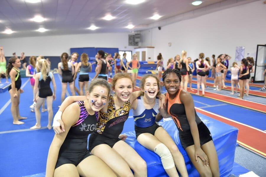 4 girls sitting on foam block, laughing
