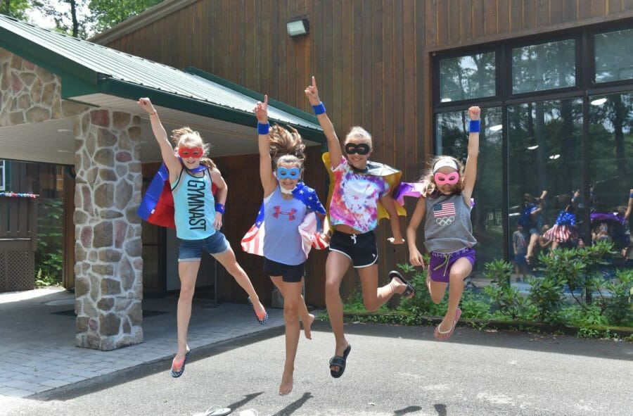 summer campers jumping in the air