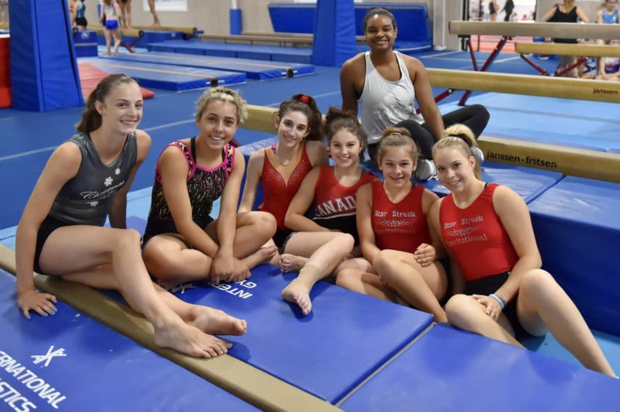 group of girls sitting on mat in IGC facility